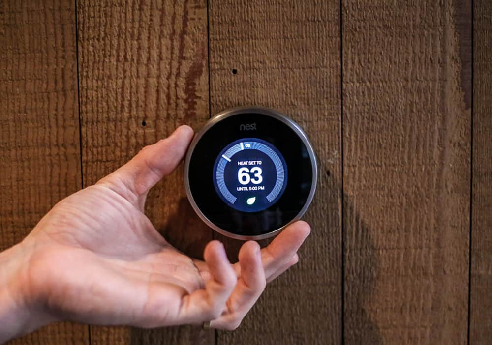 Nest Thermostat being Adjusted